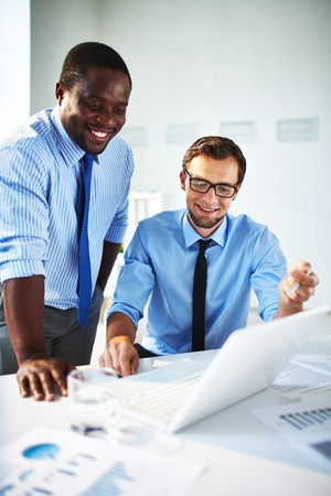 Businessman explaining something to his colleague in office