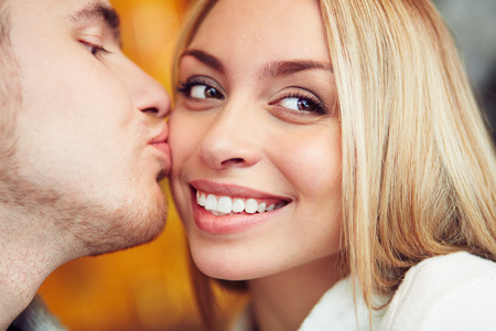 kiss couple: Close-up of happy woman being kissed