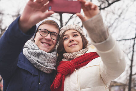 amorous: Amorous dates taking their selfie outdoors Stock Photo