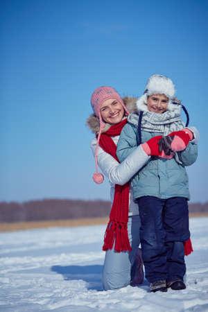 winterwear: Happy woman and her little son in winterwear