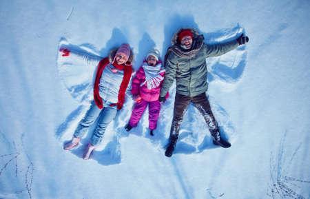 snowdrift: Young couple and cute little girl having fun in snowdrift
