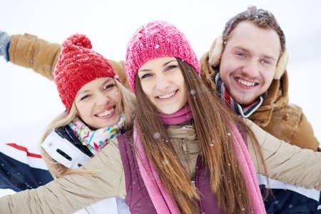 winterwear: Happy friends walking in winter