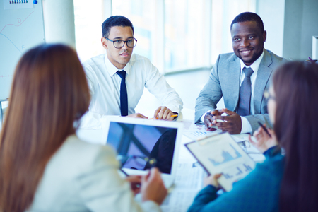 Business partners communicating at meeting Stock Photo