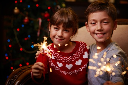 Happy siblings holding Bengal lights photo