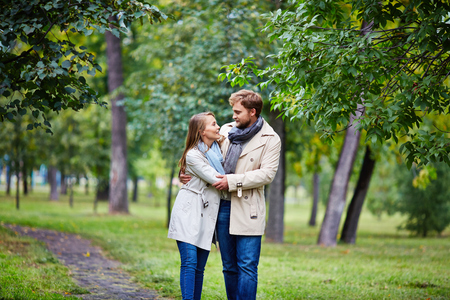 amorous woman: Amorous man and woman spending leisure in summer park Stock Photo