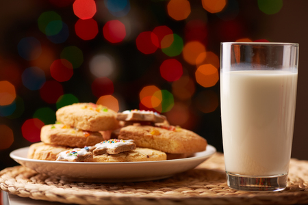 milk and cookies: Tasty cookies on plate and a glass of milk Stock Photo