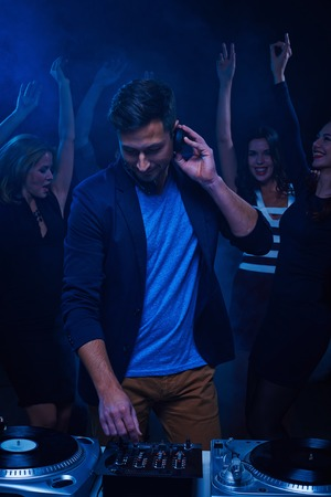 dancing club: Young stylish deejay at dancing party in night club