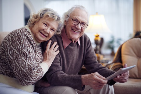 Affectionate senior couple having rest at home