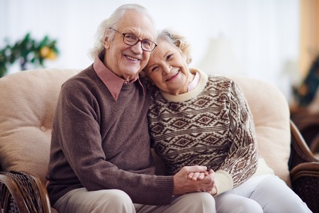 Affectionate grandparents having rest at home