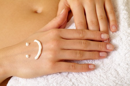 handcare: Female manicured hands on white soft towel Stock Photo