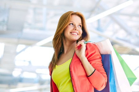 shopaholism: Young woman with shopping bags