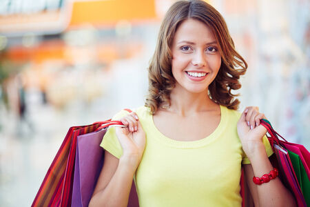 shopaholic: Pretty young shopaholic with paper-bags