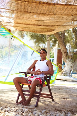 philippine adult: Happy young Latino man spending vacation at summer resort Stock Photo