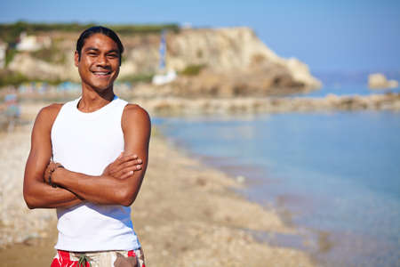 philippine adult: Happy young man having rest by the seaside