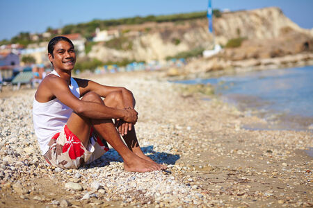 philippine adult: Happy young man relaxing on the sea coast Stock Photo
