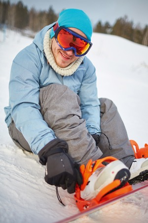activewear: Young snowboarder in winter activewear on vacations Stock Photo