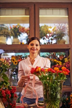 proprietor: Portrait of a woman at flower shop Stock Photo