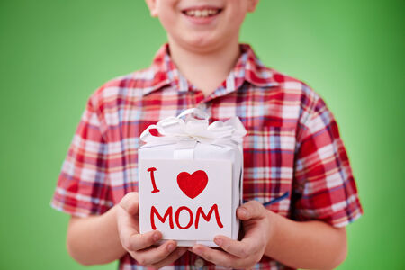 lad: Present for mother with note held by little lad Stock Photo