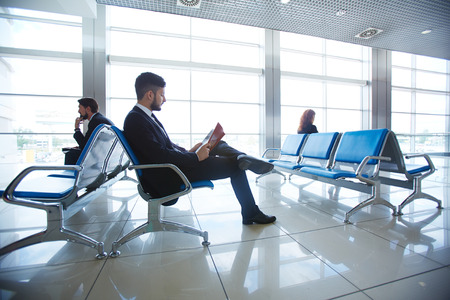 waiting man: Business people in waiting room
