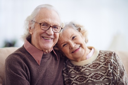 family with grandparents: Casual pensioners looking at camera with smiles