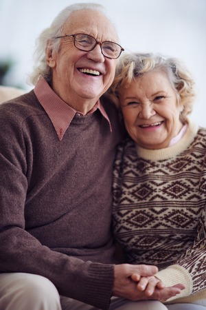 ecstatic: Ecstatic seniors in sweaters laughing