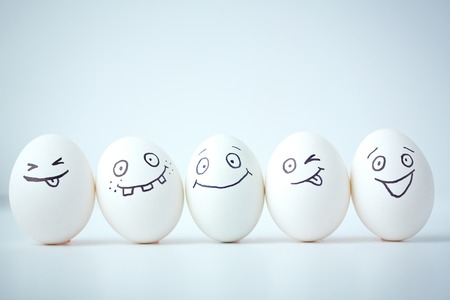 Line of eggs with different facial expressions Stock Photo