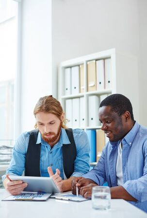 Confident businessmen or designers finding out information for new project Stock Photo
