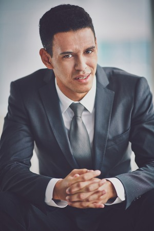 business skeptical: Confused businessman looking at camera