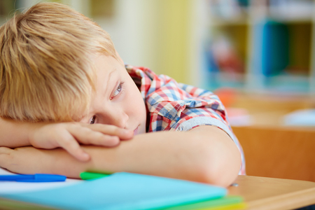 indifferent: Tired schoolboy having rest