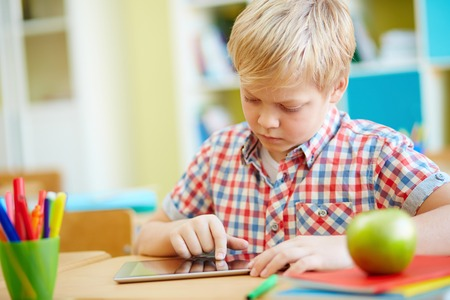 learner: Serious elementary learner using touchpad
