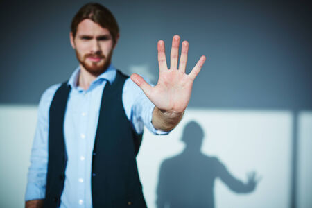 stop gesture: Young businessman showing stop gesture Stock Photo