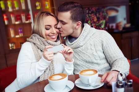 sweethearts: Young sweethearts having rest in cafe Stock Photo