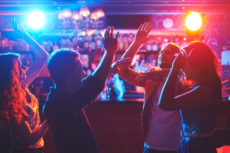 friends at bar: Young friends having great party with dancing