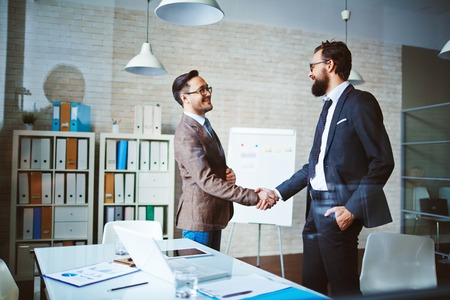 negotiation business: Successful businessmen handshaking after negotiation Stock Photo