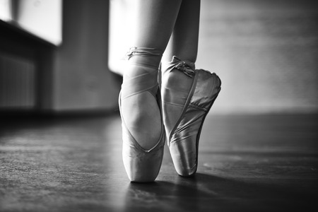 ballet shoes: Feet of dancing ballerina Stock Photo