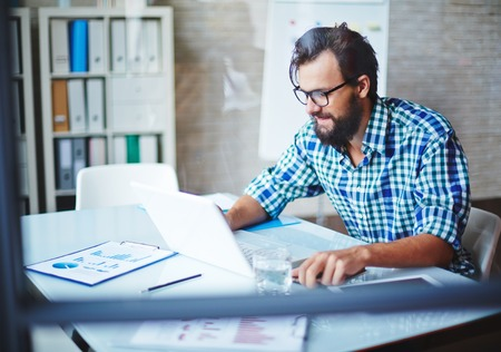 professional man: Modern businessman in casualwear networking