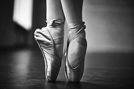 Feet of dancing ballerina during rehearsal