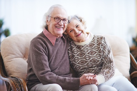 happy retirement: Affectionate couple in casualwear having rest at home