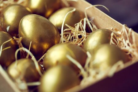 golden eggs: Golden Easter eggs in box or container