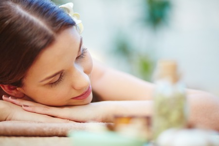 spas: Beautiful young female relaxing in spa salon Stock Photo