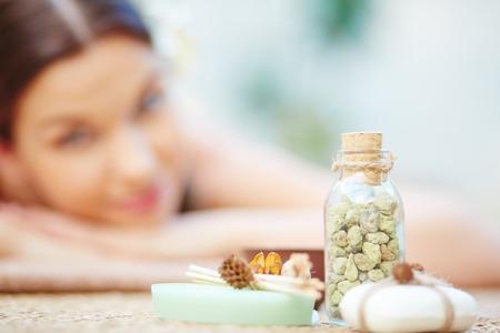 Sea salt, orange wood sticks and toilet soap for relaxing aromatherapy Foto de archivo