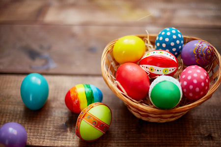 Creative Easter symbols of various colors in basket Stock Photo