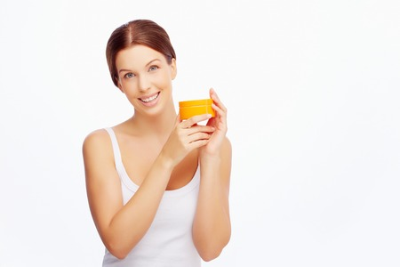 purifying: Fresh and pretty girl with cream looking at camera Stock Photo