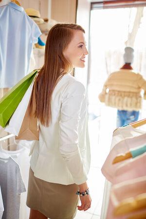 shopaholism: Beautiful customer with shopping bags