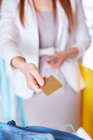 shopaholism: Female customer with plastic card