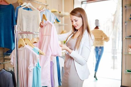 shopaholism: Beautiful young woman shopping