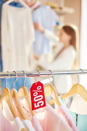 shopaholism: Half price for collection of clothes Stock Photo