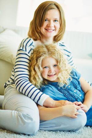 Young woman with her daughter photo