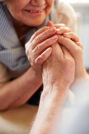 devoted: Hands of affectionate seniors Stock Photo