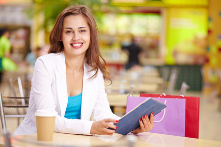 after shopping: Attractive shopper looking at camera during rest after shopping Stock Photo